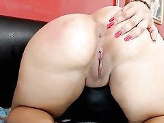 Chubby brown-haired pleasures herself on webcam