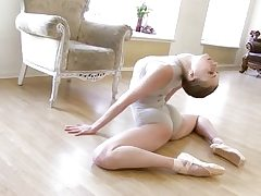 Gymnastic young shorthaired babe demonstrates skills
