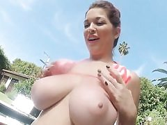 Ultra-kinky female is taking off her bikini posing with her giant titties out