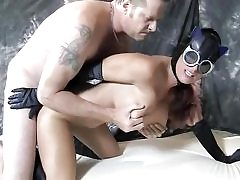 Horny looking catwoman wearing spandex fucked stiff from behind