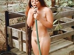 2 cowboys are spying on this nude honey taking douche outdoors