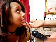 Hot girl dressed in a strap-on poking her girlfriend's nasty jaws