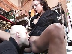 Geeky looking babe gets beaten in various poses in the shed